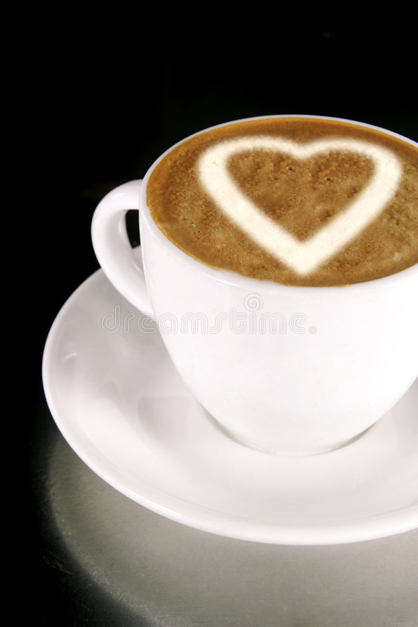Heart on Coffee. A heart on a creamy cup of cappucinno stock images