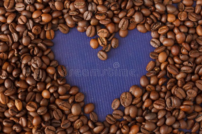 Heart Coffee Frame Made from Coffee Beans on Violet Texture Background stock images