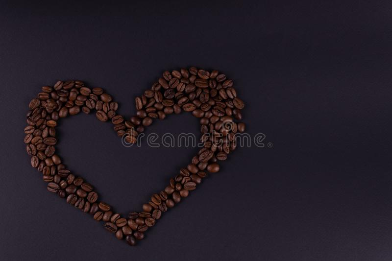 The heart of coffee is located to the left of the center of the background.  stock images