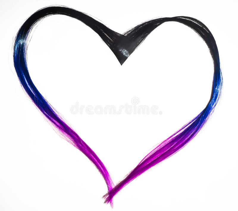 Heart of colored strands of hair. The strands are colored with purple lilac blue flowers. Beauty trend 2019 royalty free stock photos