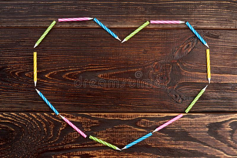 Heart from colorful Birthday candles. royalty free stock image