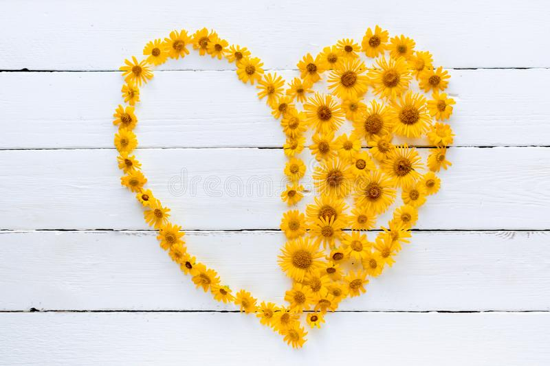 The heart is composed of beautiful orange wildflowers stock photo