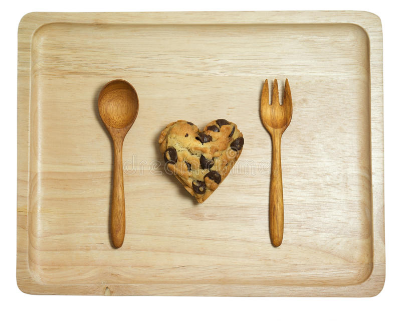Heart cookie with chocolate chips on wood tray isolated royalty free stock images