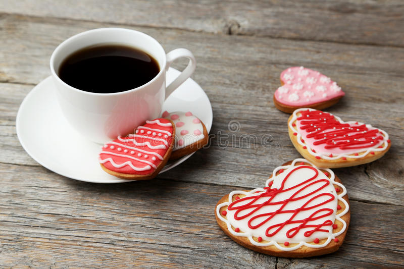 Heart cookies with cup of coffee on a grey wooden background royalty free stock photo