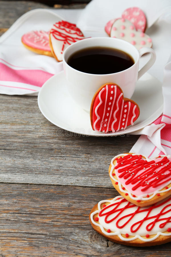 Heart cookies with cup of coffee on the grey wooden background stock photo