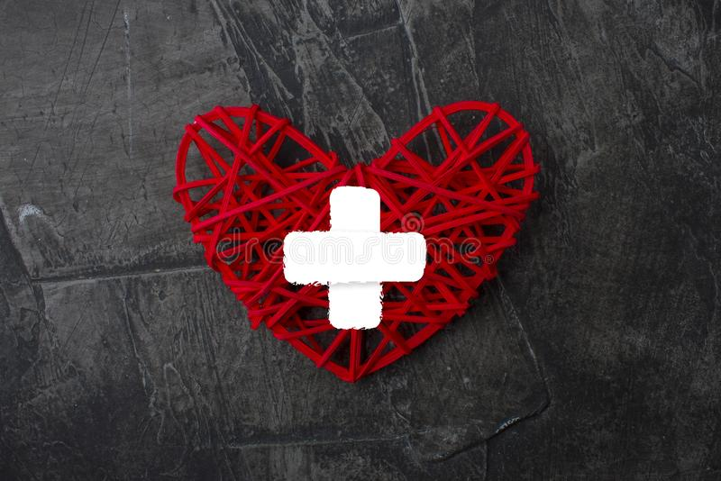 Heart with cross icon. Healthcare, Medical symbol. Doctor day sign, emblem on a dark background 1 royalty free stock photos