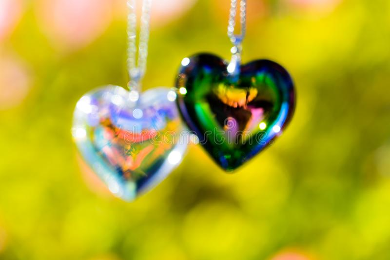 Heart crystal glass refract sunlight - sunlight clock backgroundheart crystal glass refract sunlight - rose garden background. AT 1/4/2019 in Rose garden royalty free stock photos