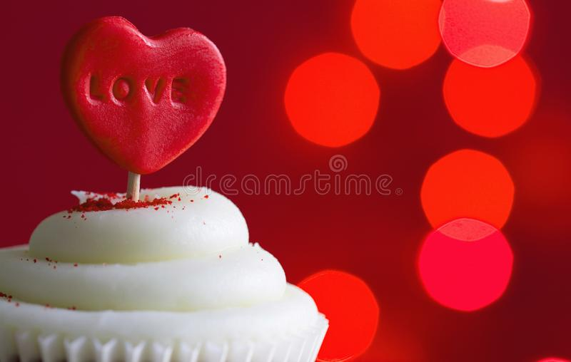 Heart in the cupcake on the love abstract defocused valentines day red background stock photo