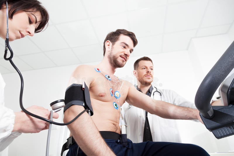 Heart diagnostic test with doctor. Doctor and nurse assist the patient during the medical examination of cardiac stress test stock photos