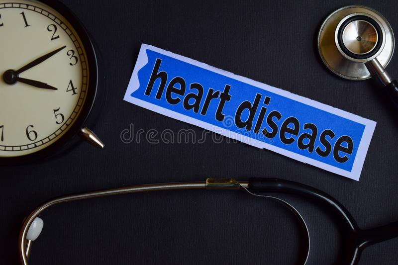 Heart Disease on the print paper with Healthcare Concept Inspiration. alarm clock, Black stethoscope. stock image