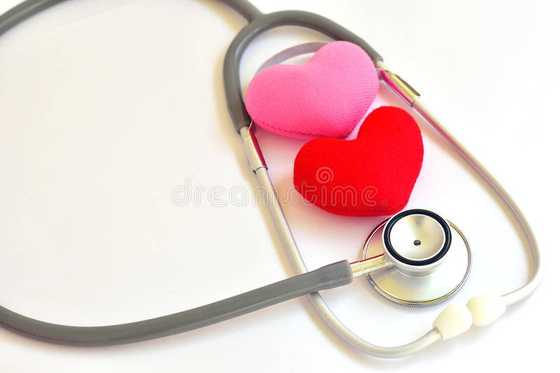 Heart disease. Heart with stethoscope, heart healthy concept stock image