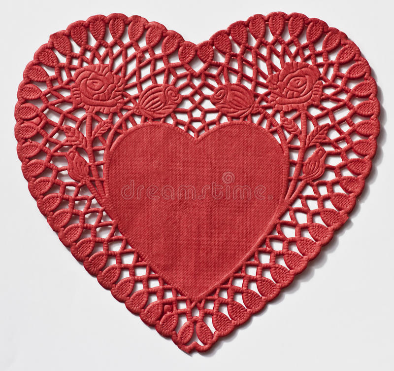 Heart Doily. Isolated on a white background royalty free stock photography