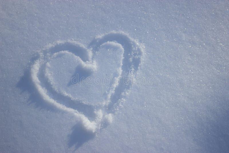 Heart drawing in fresh white snow. winter. Heart drawing in fresh white snow royalty free stock image