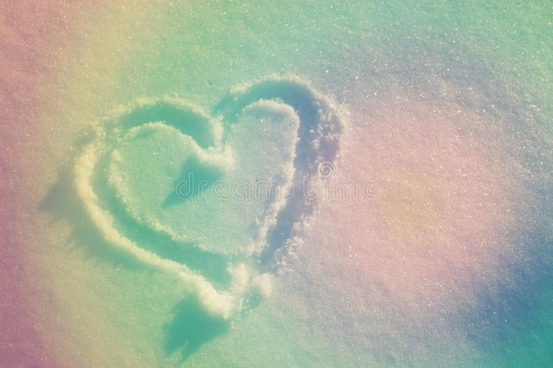 Heart drawing in fresh white snow. winter. toned image. Heart drawing in fresh white snow stock image