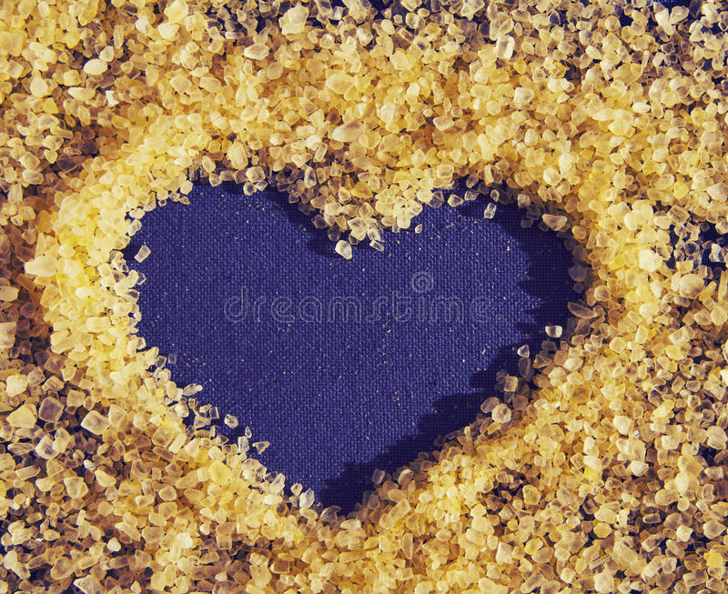 Heart drawing on an impressive surface of salt for Spa therapies. Structure of sea salt. Romantic card with hear royalty free stock photo