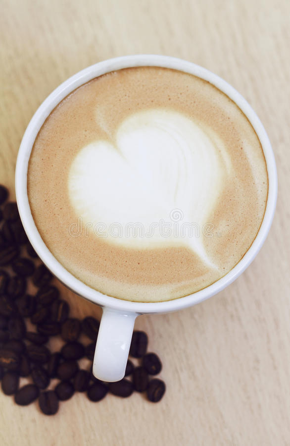 Heart drawing on latte art coffee royalty free stock photography