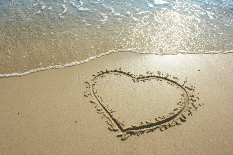 Heart drawn on sand stock photo Image of background