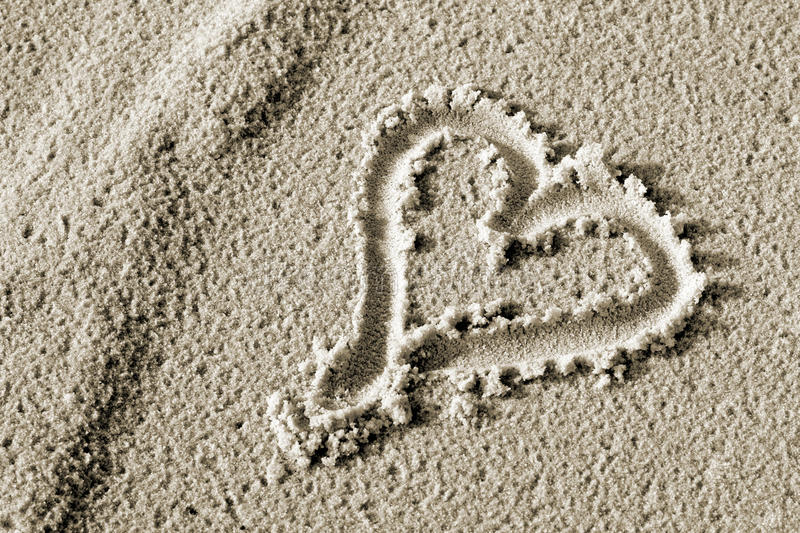 Heart drawn in the sand. royalty free stock images