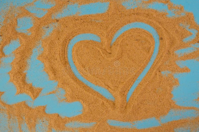 Heart drawn in the sand royalty free stock image