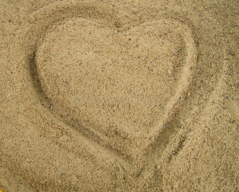 Heart drawn in the sand, a symbol of love, Valentine& x27;s royalty free stock photos