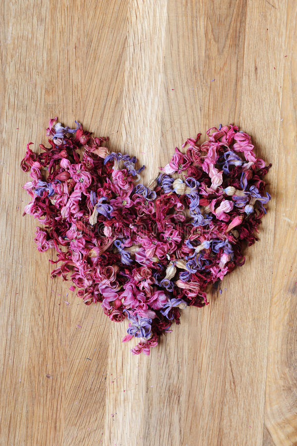 Heart of dried flowers on a wooden background royalty free stock photos