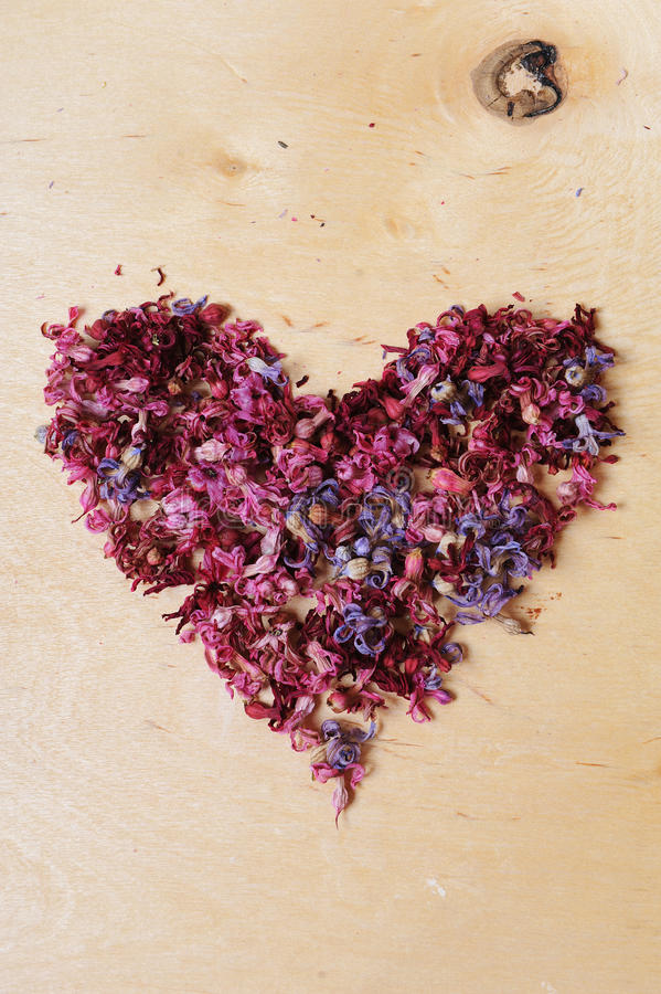 Heart of dried flowers on a wooden background royalty free stock photography