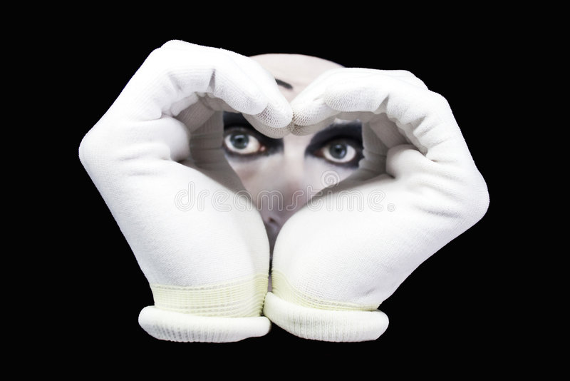 Heart and eyes of mime. On a black background royalty free stock photos