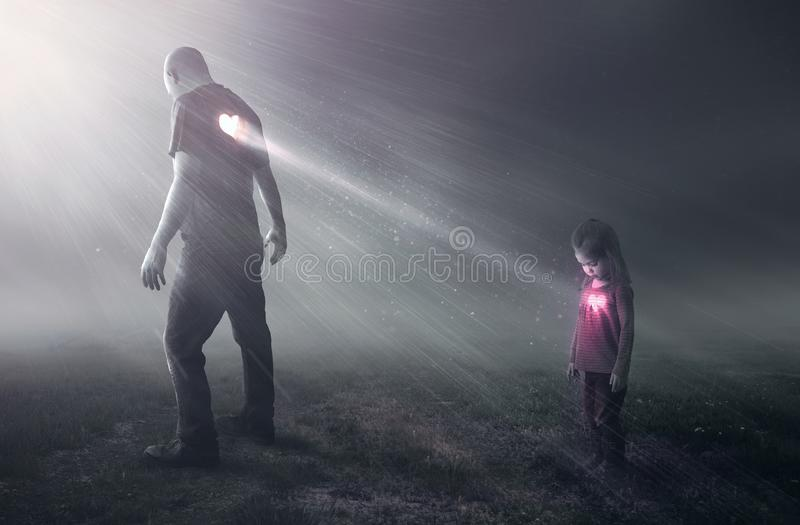 Heart of a father. A father`s open heart allows a little girl to receive his love royalty free stock image