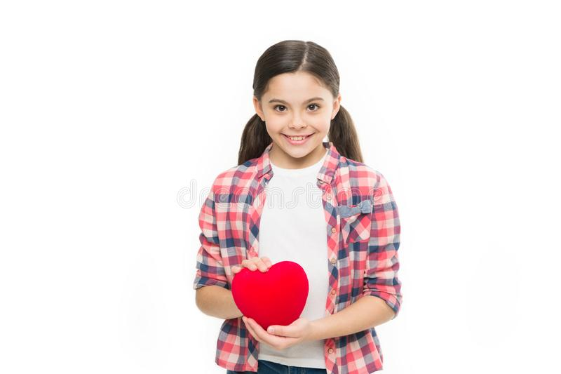 Heart filled with love. Valentines girl. Happy girl smiling with red heart. Adorable liitle child with love symbol royalty free stock image