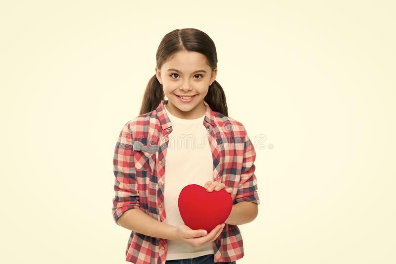 Heart filled with love. Valentines girl. Happy girl smiling with red heart. Adorable liitle child with love symbol stock photography