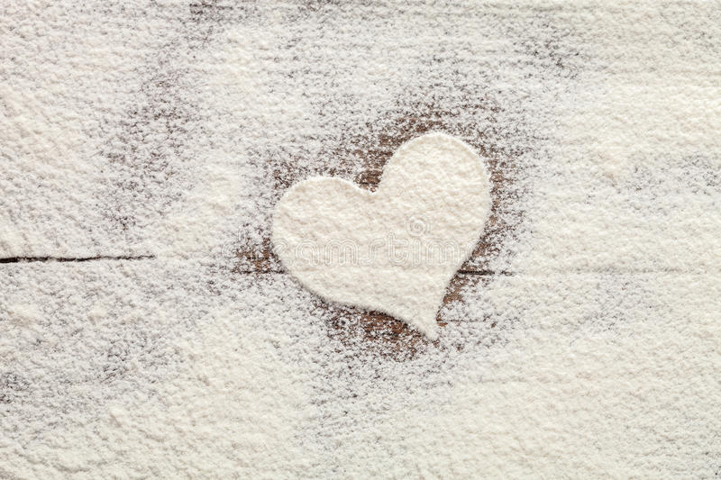Heart of the flour baking background. Easter concept. stock photography