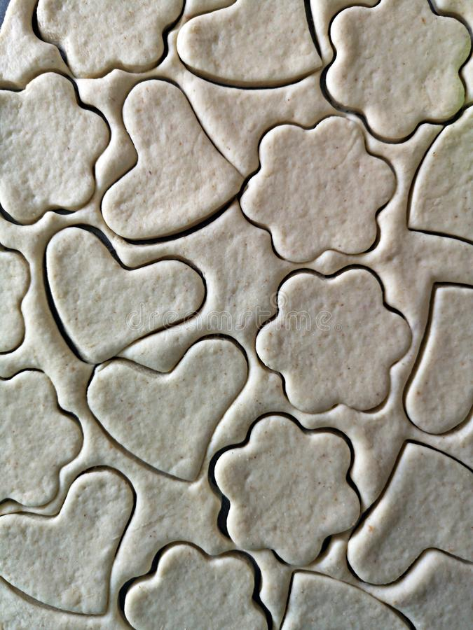 Heart and flower shaped dough for cookies. Homemade dessert  - cooking  at home stock photography