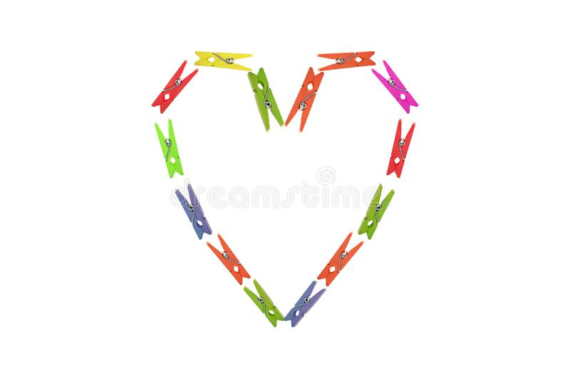 Heart form of clothespins on white background stock photos