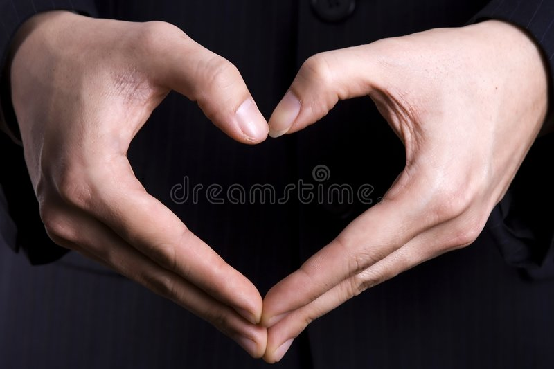 Heart Gesture. A heart gesture in black isolated background stock photography