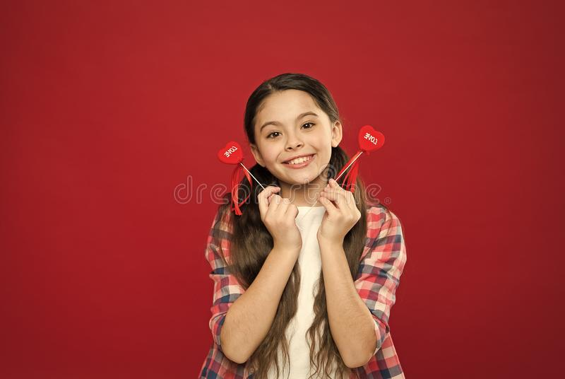 Heart gift or present. Greeting from sincere heart. Girl child hold heart symbol love. Celebrate valentines day. Fall in stock photos