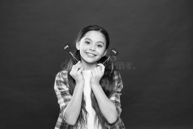 Heart gift or present. Greeting from sincere heart. Girl child hold heart symbol love. Celebrate valentines day. Fall in royalty free stock image