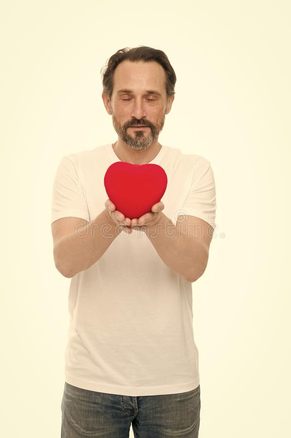 Heart gift or present. Greeting from sincere heart. Man bearded hipster hold heart. Celebrate valentines day. Love and royalty free stock images