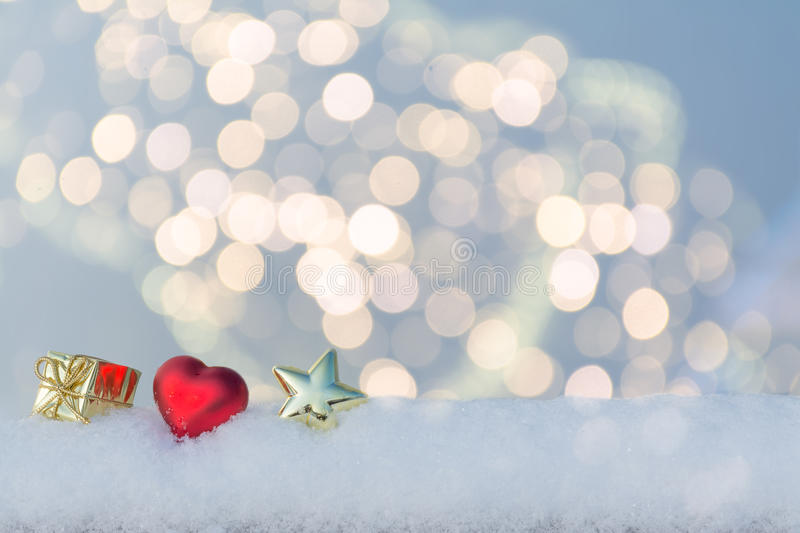 Heart, gift and star on snow. royalty free stock photography