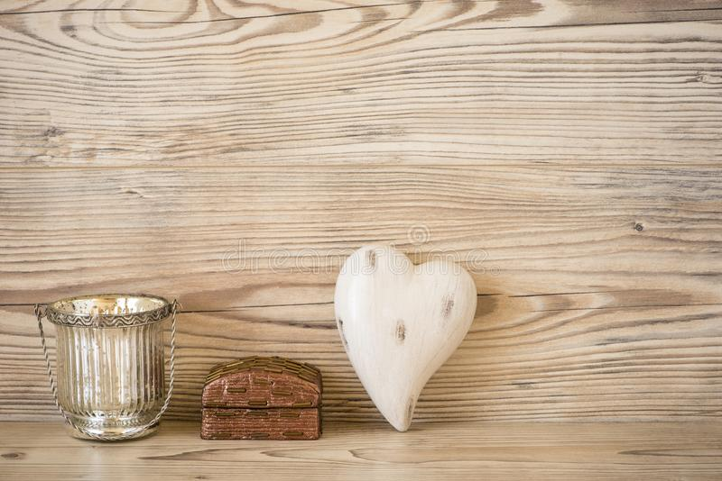 Heart, gift and tealight. In front of a wood background royalty free stock photography