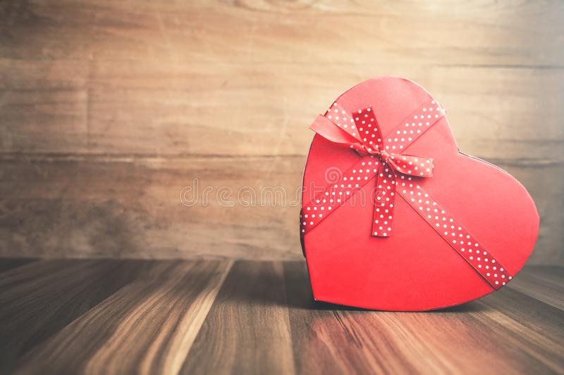 Heart gift on the wood background. royalty free stock photos