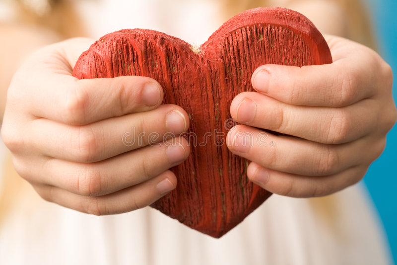 Heart in hands stock photo