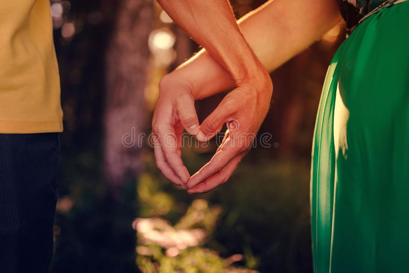 Heart from the hands of husband and wife. Love and the relationship of two lovers. Heart from the hands of husband and wife. Love and relationships of two loving royalty free stock photo
