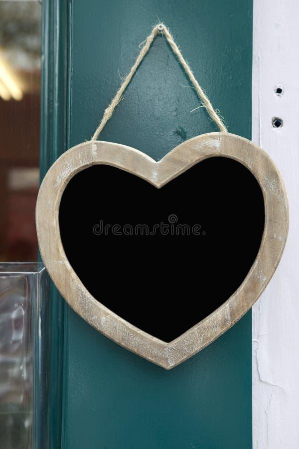 Heart hanging on door shop. Wooden heart with sign on door shop royalty free stock images
