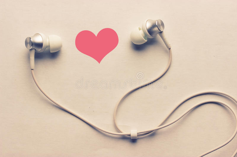 Heart and headphones stock photography