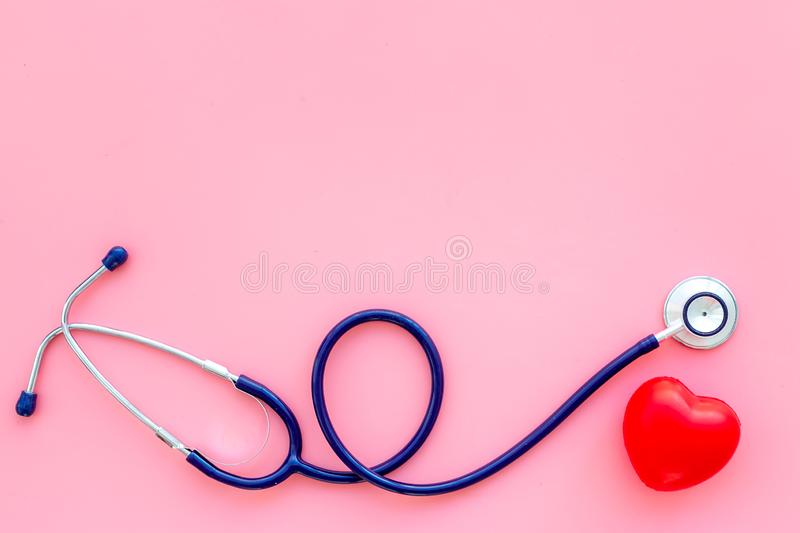 Heart health, health care concept. Stethoscope near rubber heart on pink background top view space for text stock images