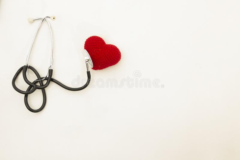 Heart health. Stethoscope and red heart of Crochet royalty free stock photo