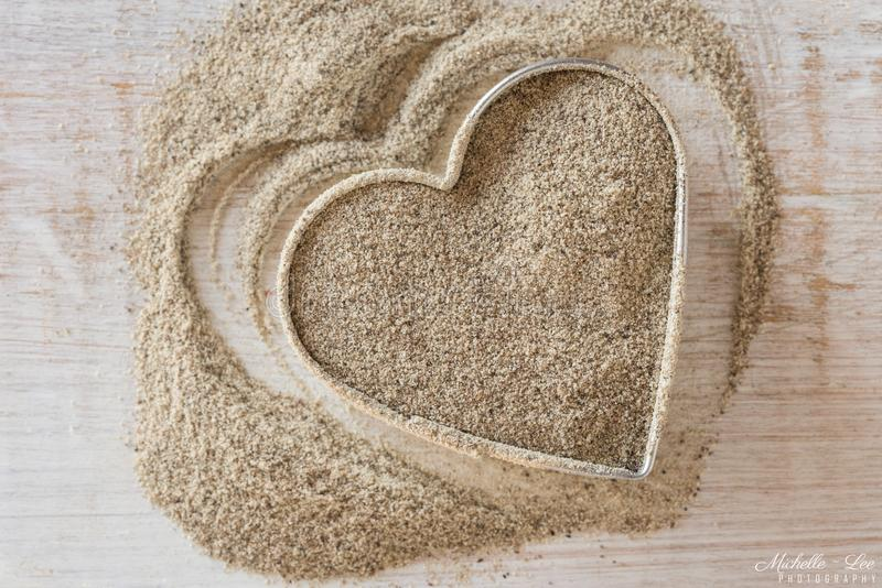 Ground White Pepper in a Heart Shape. Close up view of ground white pepper in the shape of a heart stock images