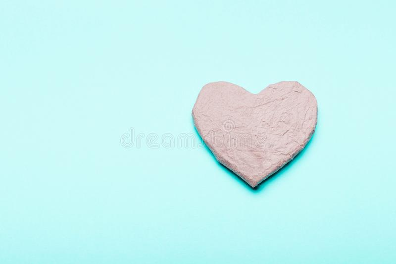 Heart from kraft cardboard, paper .Eco friendly. Heart from kraft cardboard; paper on blue background. Concept zero waste; protection of nature; the environment stock images