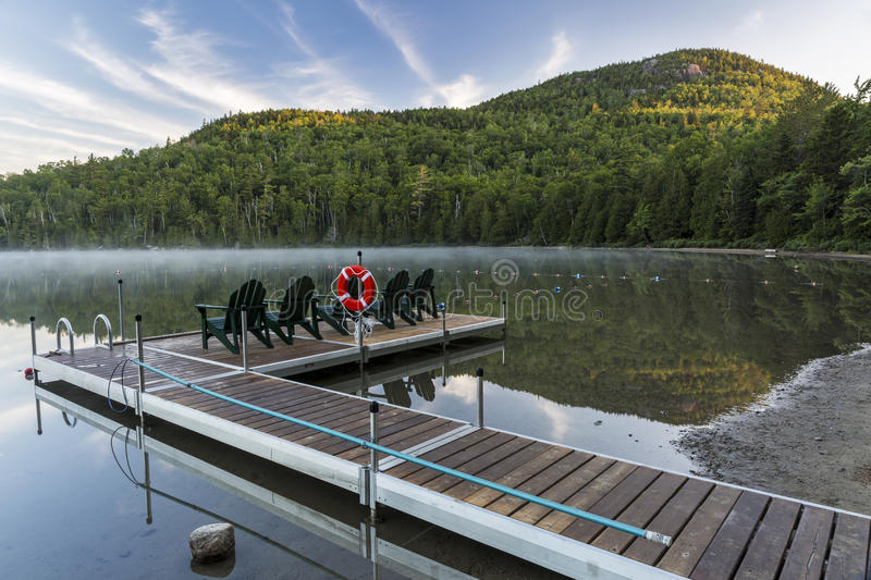 Heart Lake Dock & Mount Jo. Mount Jo rises over the Heart Lake dock on a misty morning in the High Peaks region of the Adirondack Mountains near Lake Placid, NY stock photos