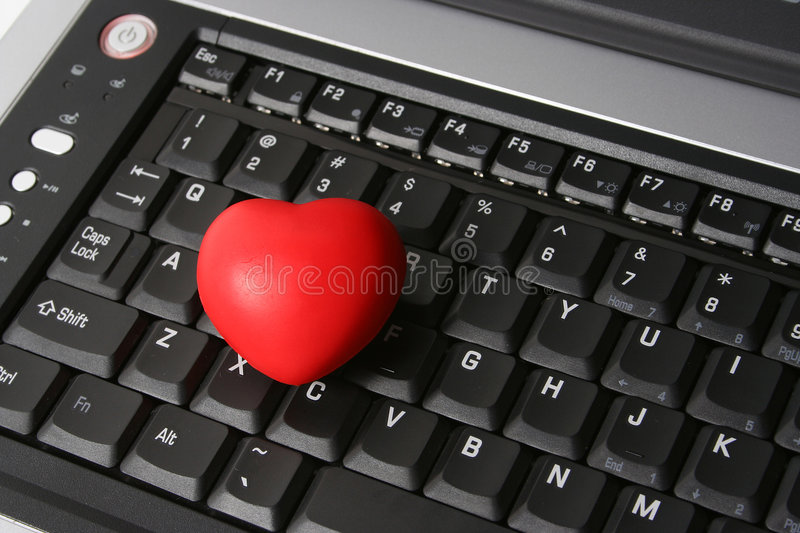 HEART ON LAPTOP. Red heart on laptop keyboard royalty free stock photos